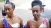 Diane Rwigara and her mother walk to the Electoral Commission