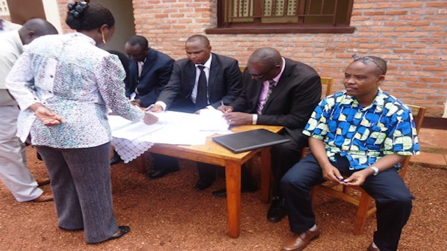 Alfred Nkubili, Rwandan Businessman signing business deals